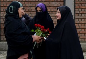 Members of International Muslim Unity Council, presenting roses to veiled girls as part of their initiative to encourage adherence to the Islamic dress code at M A Road. Pic By Xuhaib Muqbool