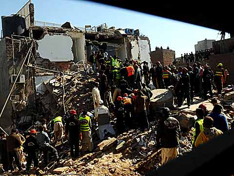 Pakistan Factory Collapses, Killing at Least 18, Scores Trapped