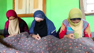 A Group Of Women In Srinagar Outskirts Weaving Namda